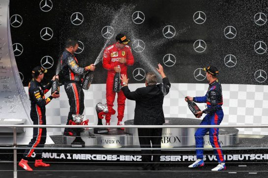 Race winner Max Verstappen (NLD) Red Bull Racing celebrates on the podium with Sebastian Vettel (GER) Ferrari and Daniil Kvyat (RUS) Scuderia Toro Rosso. 28.07.2019. Formula 1 World Championship, Rd 11, German Grand Prix, Hockenheim, Germany, Race Day. - www.xpbimages.com, EMail: requests@xpbimages.com - copy of publication required for printed pictures. Every used picture is fee-liable. © Copyright: Moy / XPB Images