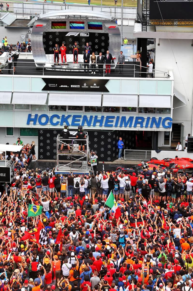 Sebastian Vettel (GER) Ferrari, second; Max Verstappen (NLD) Red Bull Racing, race winner; Daniil Kvyat (RUS) Scuderia Toro Rosso, third.