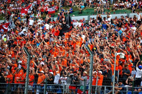 Max Verstappen (NLD) Red Bull Racing fans in the grandstand celebrates pole position.
