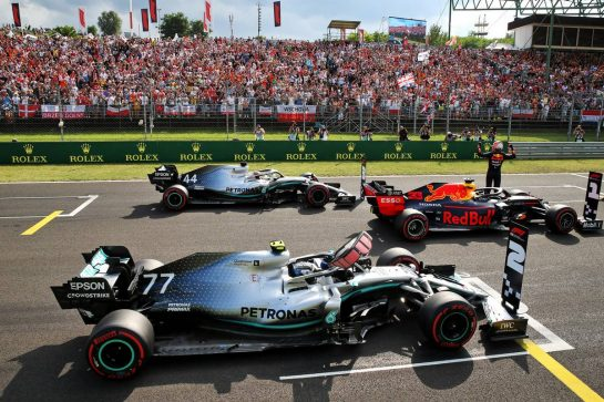 Max Verstappen (NLD) Red Bull Racing RB15 celebrates his pole position in qualifying parc ferme with Valtteri Bottas (FIN) Mercedes AMG F1 W10 and Lewis Hamilton (GBR) Mercedes AMG F1 W10.