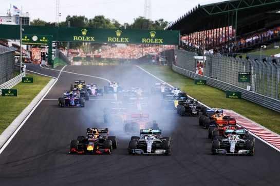 (L to R): Max Verstappen (NLD) Red Bull Racing RB15, Valtteri Bottas (FIN) Mercedes AMG F1 W10, and Lewis Hamilton (GBR) Mercedes AMG F1 W10, at the start of the race. 04.08.2019. Formula 1 World Championship, Rd 12, Hungarian Grand Prix, Budapest, Hungary, Race Day. - www.xpbimages.com, EMail: requests@xpbimages.com - copy of publication required for printed pictures. Every used picture is fee-liable. © Copyright: Moy / XPB Images