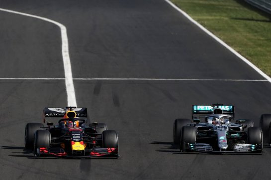 (L to R): Max Verstappen (NLD) Red Bull Racing RB15 and Lewis Hamilton (GBR) Mercedes AMG F1 W10 battle for the lead of the race.
