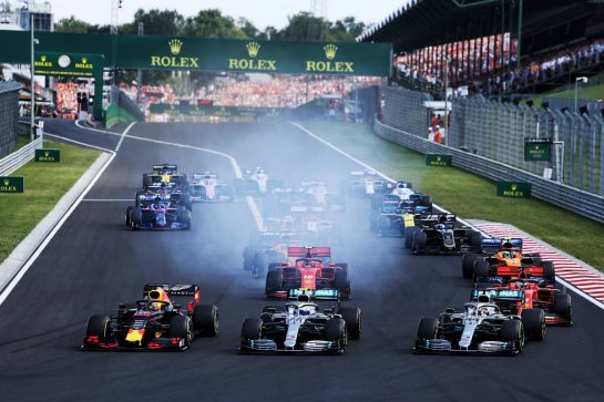 (L to R): Max Verstappen (NLD) Red Bull Racing RB15; Valtteri Bottas (FIN) Mercedes AMG F1 W10; and Lewis Hamilton (GBR) Mercedes AMG F1 W10, at the start of the race. 04.08.2019. Formula 1 World Championship, Rd 12, Hungarian Grand Prix, Budapest, Hungary, Race Day. - www.xpbimages.com, EMail: requests@xpbimages.com - copy of publication required for printed pictures. Every used picture is fee-liable. © Copyright: Moy / XPB Images
