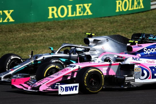 Valtteri Bottas (FIN) Mercedes AMG F1 W10 and Lance Stroll (CDN) Racing Point F1 Team RP19 battle for position.