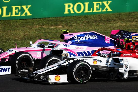 Lance Stroll (CDN) Racing Point F1 Team RP19 and Antonio Giovinazzi (ITA) Alfa Romeo Racing C38 battle for position.