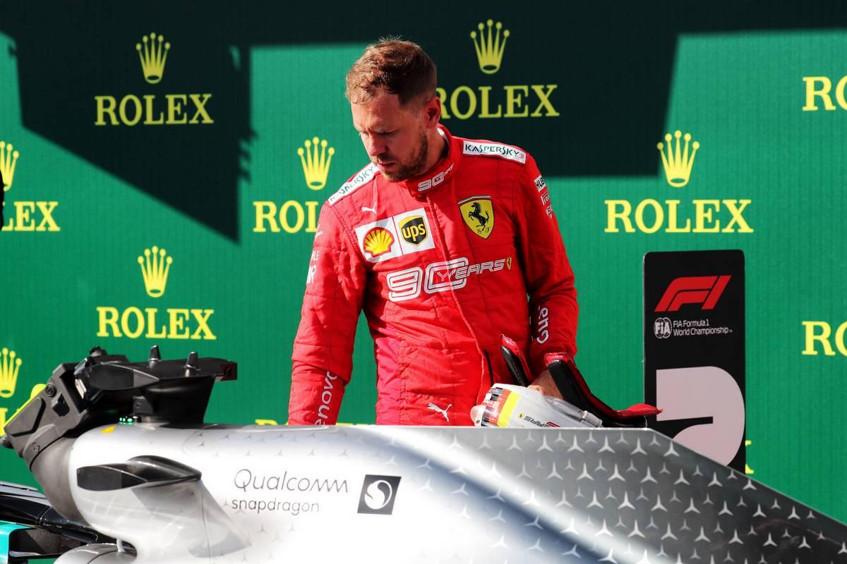 Sebastian Vettel (GER) Ferrari in parc ferme.