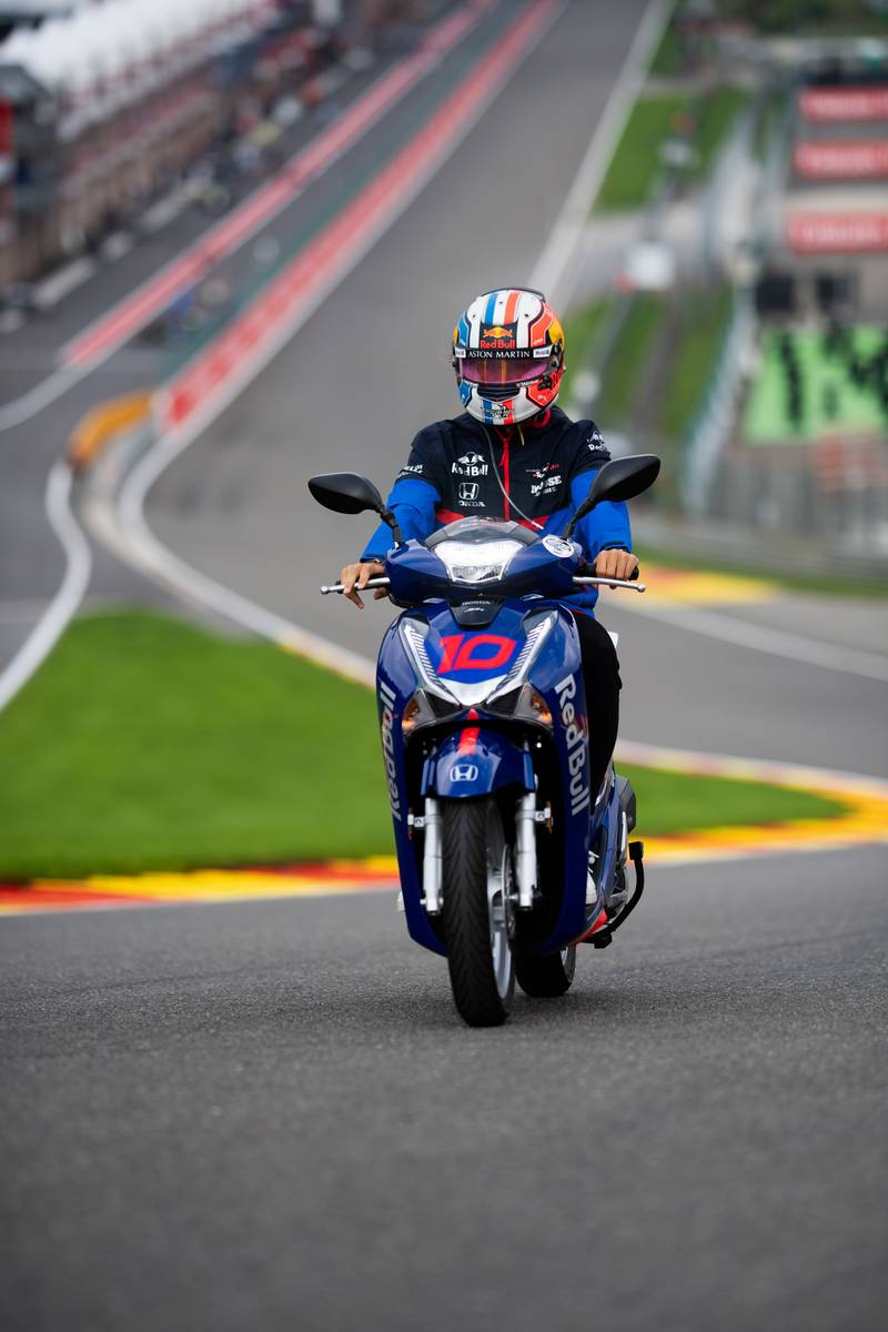 Pierre Gasly (FRA) Scuderia Toro Rosso rides the circuit on a scooter.