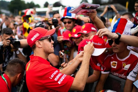Sebastian Vettel (GER) Ferrari signs autographs for the fans.