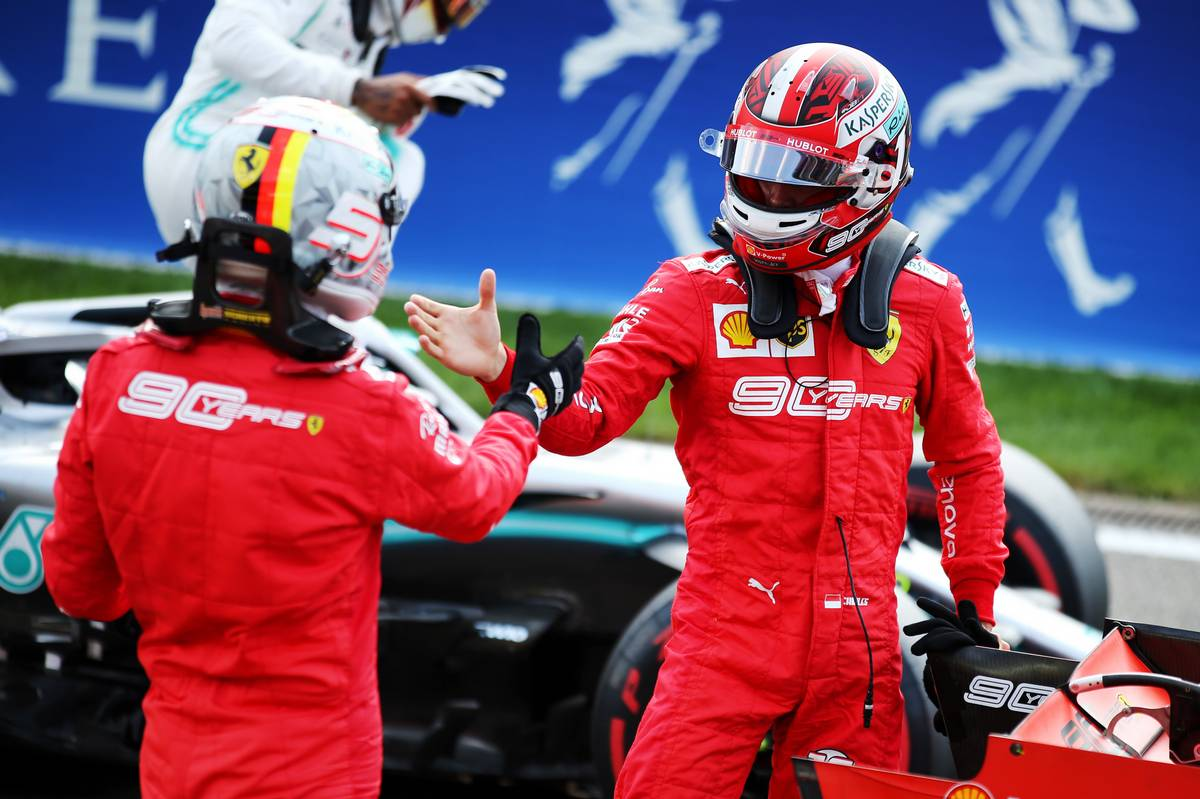 Charles Leclerc (MON) Ferrari celebrates his pole position in qualifying parc ferme with team mate Sebastian Vettel (GER) Ferrari.