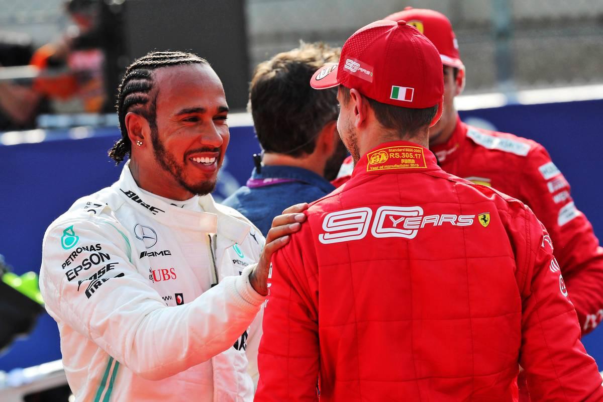Lewis Hamilton (GBR) Mercedes AMG F1 with Sebastian Vettel (GER) Ferrari in qualifying parc ferme.