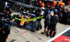Lando Norris (GBR) McLaren MCL34 in the pits.