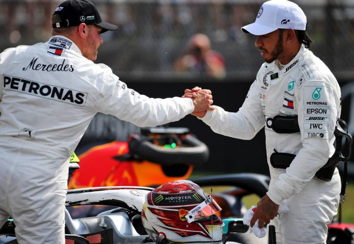 Lewis Hamilton (GBR) Mercedes AMG F1 celebrates his pole position in qualifying parc ferme with third placed team mate Valtteri Bottas (FIN)