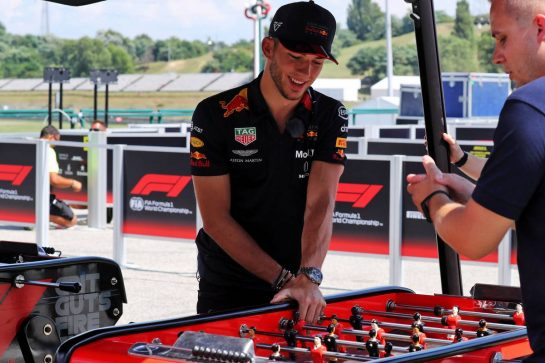 Pierre Gasly (FRA) Red Bull Racing plays table football.