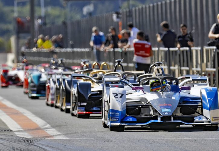 Formula E cars line-up in the pit lane to head out on track.