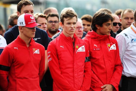 F1, F2, and F3 pay their respects to Anthoine Hubert: (L to R): Mick Schumacher (GER); Callum Ilott (GBR) and Giuliano Alesi (FRA) Ferrari Academy Drivers.
