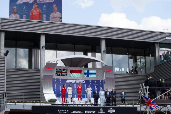 The podium (L to R): Laurent Mekies (FRA) Ferrari Sporting Director; Lewis Hamilton (GBR) Mercedes AMG F1, second; Charles Leclerc (MON) Ferrari, race winner; Valtteri Bottas (FIN) Mercedes AMG F1, third.