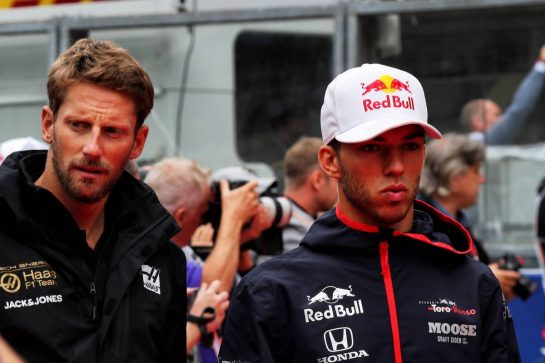 (L to R): Romain Grosjean (FRA) Haas F1 Team and Pierre Gasly (FRA) Scuderia Toro Rosso on the drivers parade.