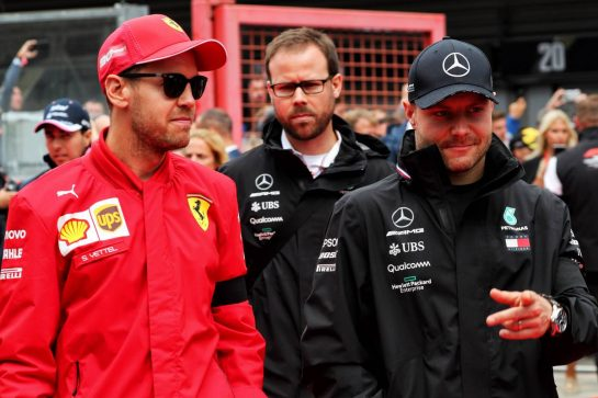 (L to R): Sebastian Vettel (GER) Ferrari with Valtteri Bottas (FIN) Mercedes AMG F1 on the drivers parade.