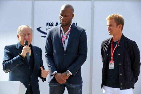 (L to R): Jean Todt (FRA) FIA President with Didier Drogba (CIV) Former Football Player and Nico Rosberg (GER) at an FIA Road Safety Campaign.