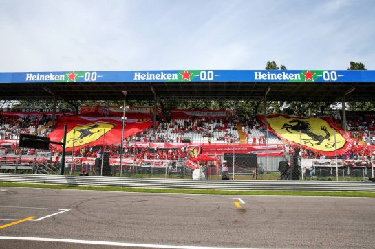 Ferrari flags with fans in the grandstand.