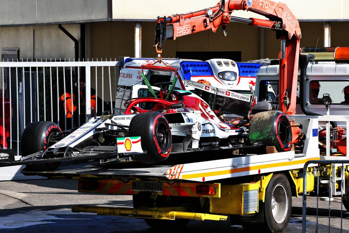 The Alfa Romeo Racing C38 of Kimi Raikkonen (FIN) Alfa Romeo Racing is recovered back to the pits on the back of a truck after crashing during qualifying.