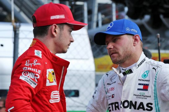 (L to R): Charles Leclerc (MON) Ferrari in qualifying parc ferme with Valtteri Bottas (FIN) Mercedes AMG F1.