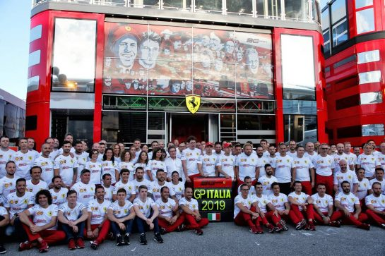 Ferrari celebrates 90th anniversary at a team photograph.
