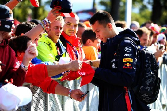 Alexander Albon (THA) Red Bull Racing signs autographs for the fans.