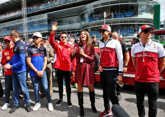 (L to R): Sebastian Vettel (GER) Ferrari; Daniil Kvyat (RUS) Scuderia Toro Rosso; Pierre Gasly (FRA) Scuderia Toro Rosso; Charles Leclerc (MON) Ferrari; Federica Masolin (ITA) Sky F1 Italia Presenter; Antonio Giovinazzi (ITA) Alfa Romeo Racing; and Kimi Raikkonen (FIN) Alfa Romeo Racing, on the drivers parade.