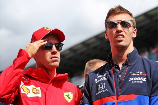 (L to R): Sebastian Vettel (GER) Ferrari and Daniil Kvyat (RUS) Scuderia Toro Rosso on the drivers parade.