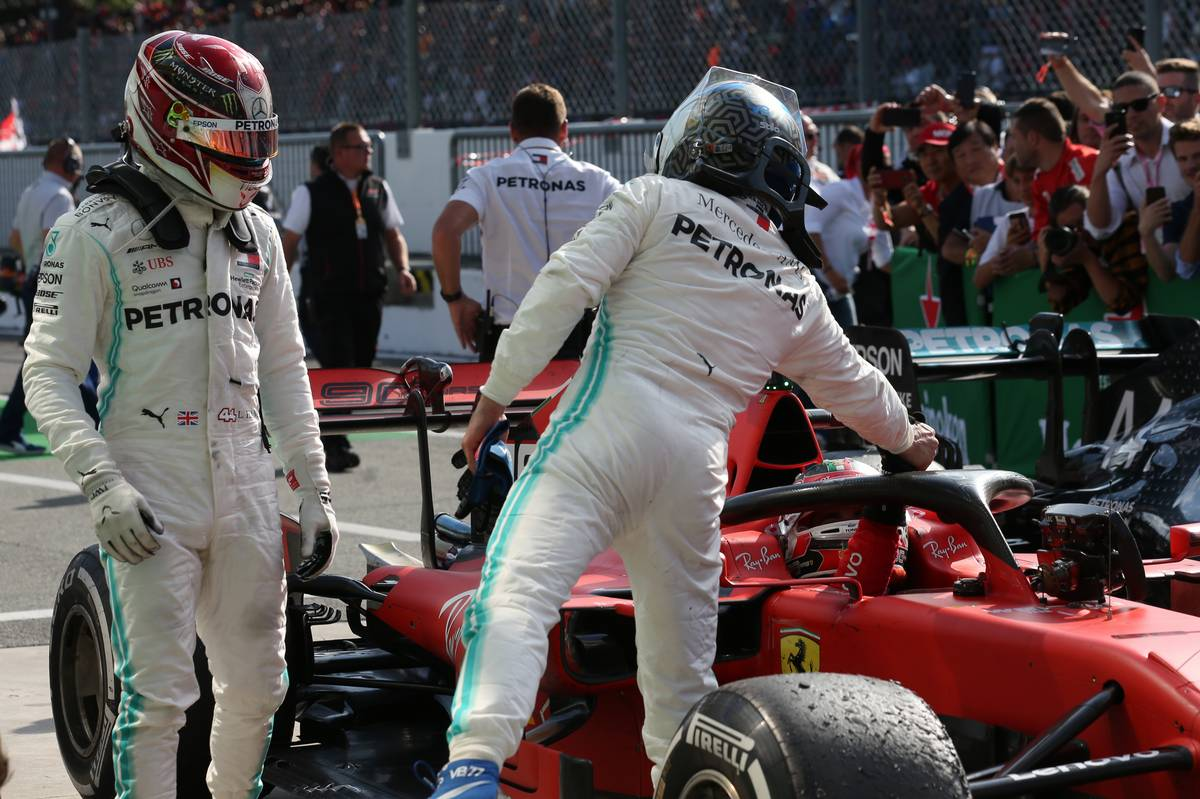 Lewis Hamilton (GBR) Mercedes AMG F1 W10 and Valtteri Bottas (FIN) Mercedes AMG F1 W10 congratulate Charles Leclerc