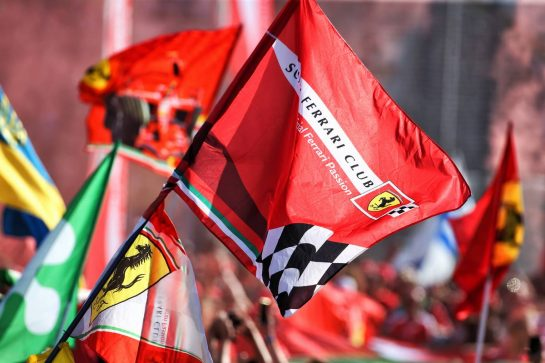 Ferrari fans celebrate at the podium.
