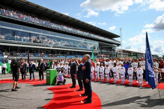 The grid observes the national anthem. 08.09.2019. Formula 1 World Championship, Rd 14, Italian Grand Prix, Monza, Italy, Race Day. - www.xpbimages.com, EMail: requests@xpbimages.com - copy of publication required for printed pictures. Every used picture is fee-liable. © Copyright: Batchelor / XPB Images
