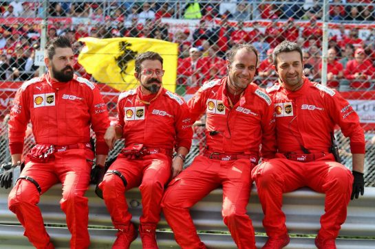 Ferrari mechanics on the grid.
