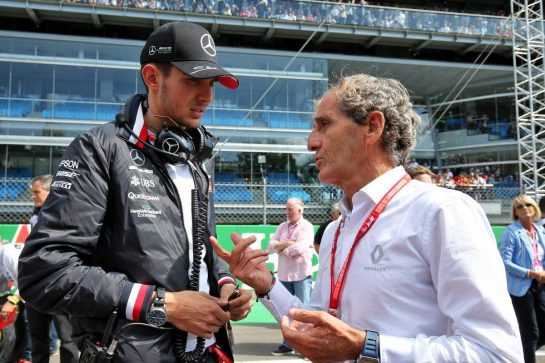 Esteban Ocon (FRA) Mercedes AMG F1 Reserve Driver with Alain Prost (FRA) Renault F1 Team Special Advisor on the grid.