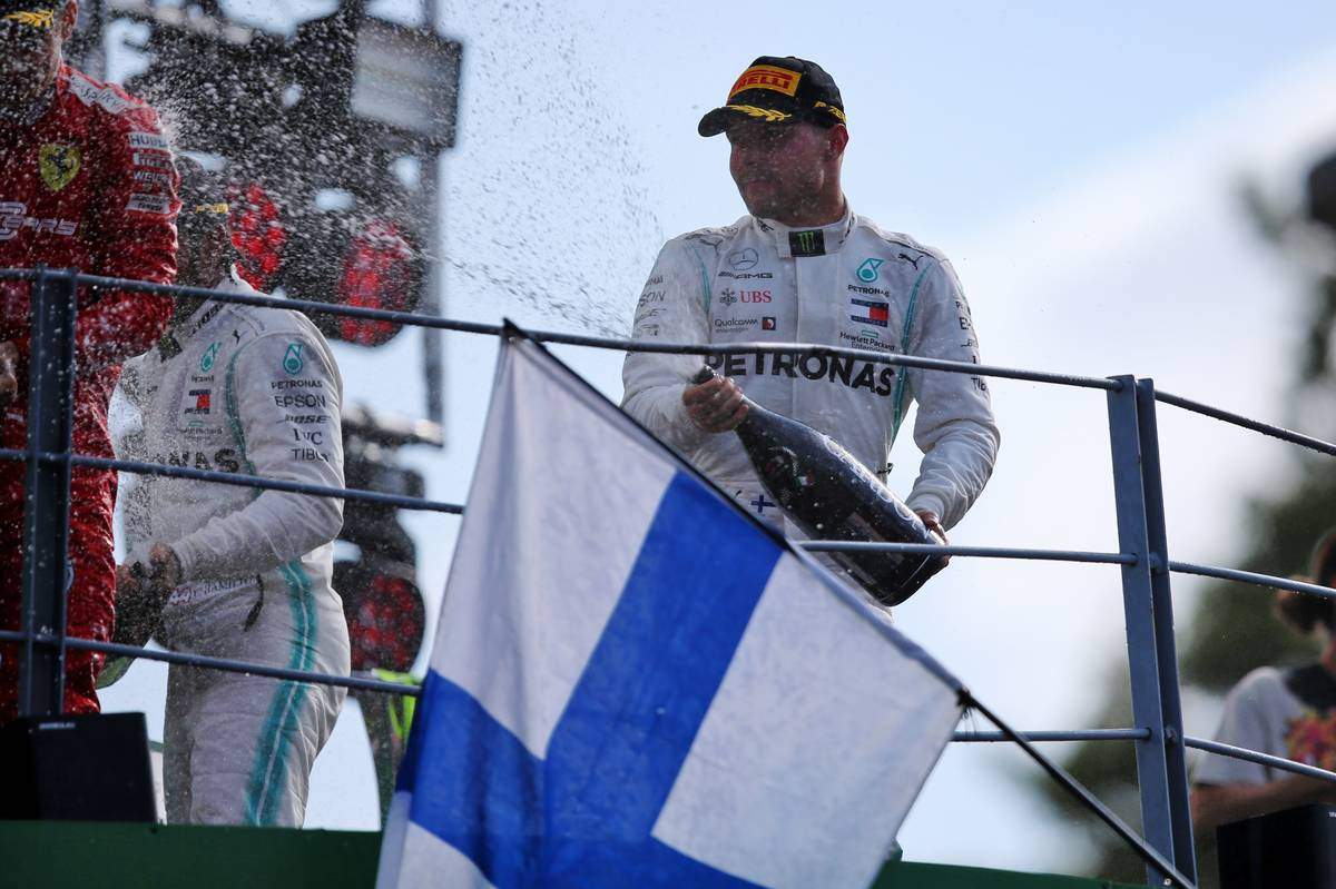 Valtteri Bottas (FIN) Mercedes AMG F1 celebrates his second position on the podium.