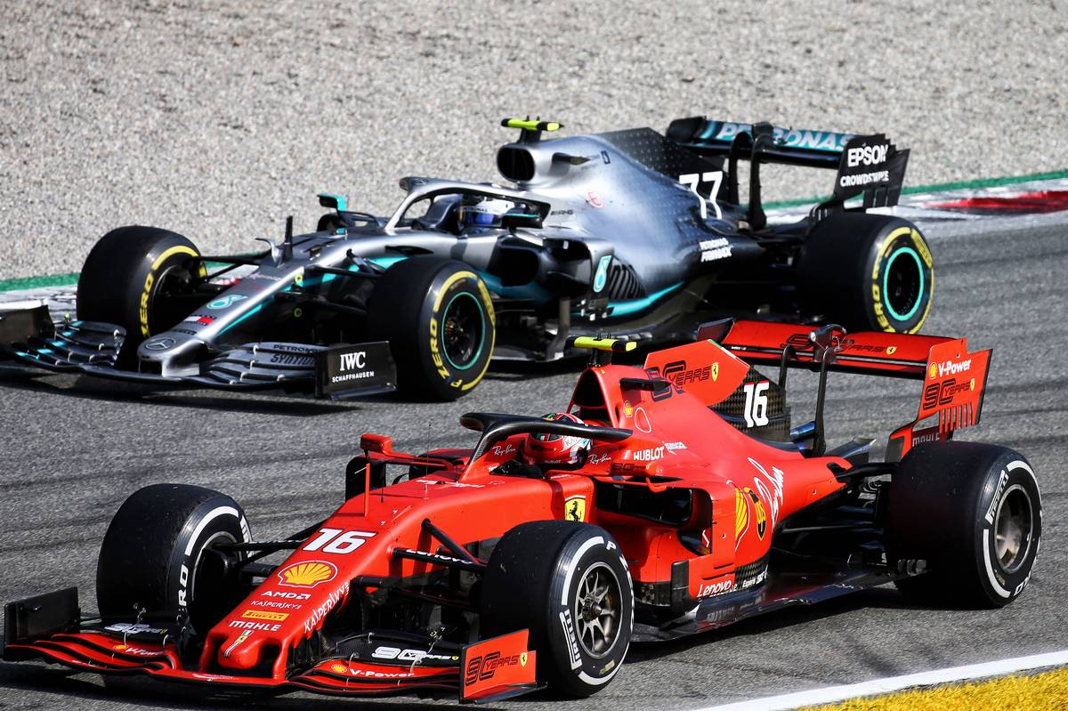 Race winner Charles Leclerc (MON) Ferrari SF90 celebrates at the end of the race with Valtteri Bottas (FIN) Mercedes AMG F1 W10.