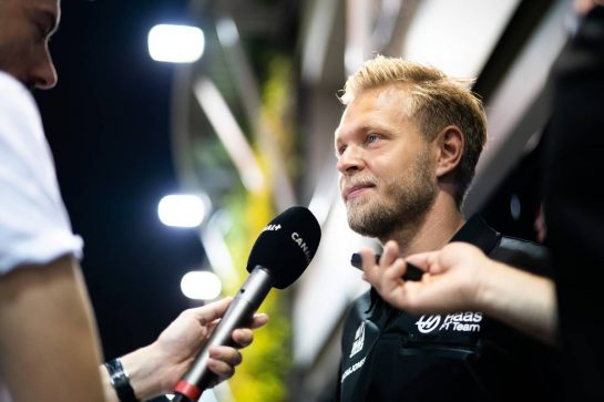 Kevin Magnussen (DEN) Haas F1 Team with the media.