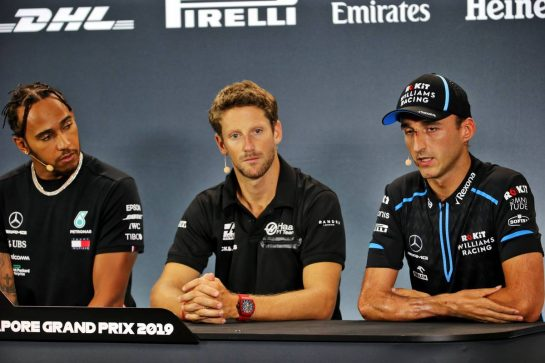 (L to R): Lewis Hamilton (GBR) Mercedes AMG F1; Romain Grosjean (FRA) Haas F1 Team; and Robert Kubica (POL) Williams Racing, in the FIA Press Conference. 19.09.2019. Formula 1 World Championship, Rd 15, Singapore Grand Prix, Marina Bay Street Circuit, Singapore, Preparation Day.  - www.xpbimages.com, EMail: requests@xpbimages.com - copy of publication required for printed pictures. Every used picture is fee-liable. © Copyright: Bearne / XPB Images