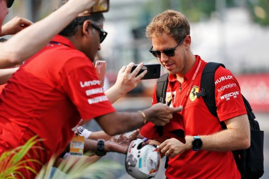 Sebastian Vettel (GER) Ferrari signs autographs for the fans. 21.09.2019. Formula 1 World Championship, Rd 15, Singapore Grand Prix, Marina Bay Street Circuit, Singapore, Qualifying Day.  - www.xpbimages.com, EMail: requests@xpbimages.com - copy of publication required for printed pictures. Every used picture is fee-liable. © Copyright: Dungan / XPB Images
