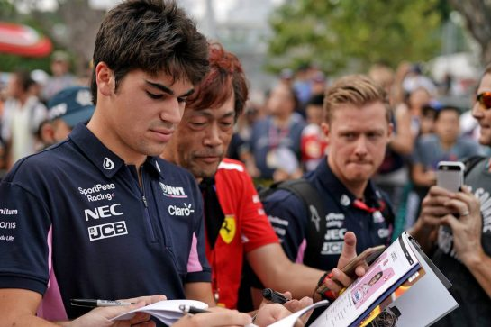 Lance Stroll (CDN) Racing Point F1 Team signs autographs for the fans. 21.09.2019. Formula 1 World Championship, Rd 15, Singapore Grand Prix, Marina Bay Street Circuit, Singapore, Qualifying Day.  - www.xpbimages.com, EMail: requests@xpbimages.com - copy of publication required for printed pictures. Every used picture is fee-liable. © Copyright: Dungan / XPB Images