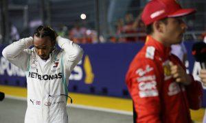 Lewis Hamilton (GBR) Mercedes AMG F1 W10 and Charles Leclerc (MON) Ferrari SF90.