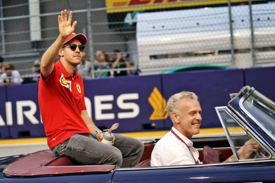 Sebastian Vettel (GER) Ferrari on the drivers parade. 22.09.2019. Formula 1 World Championship, Rd 15, Singapore Grand Prix, Marina Bay Street Circuit, Singapore, Race Day.  - www.xpbimages.com, EMail: requests@xpbimages.com - copy of publication required for printed pictures. Every used picture is fee-liable. © Copyright: Dungan / XPB Images