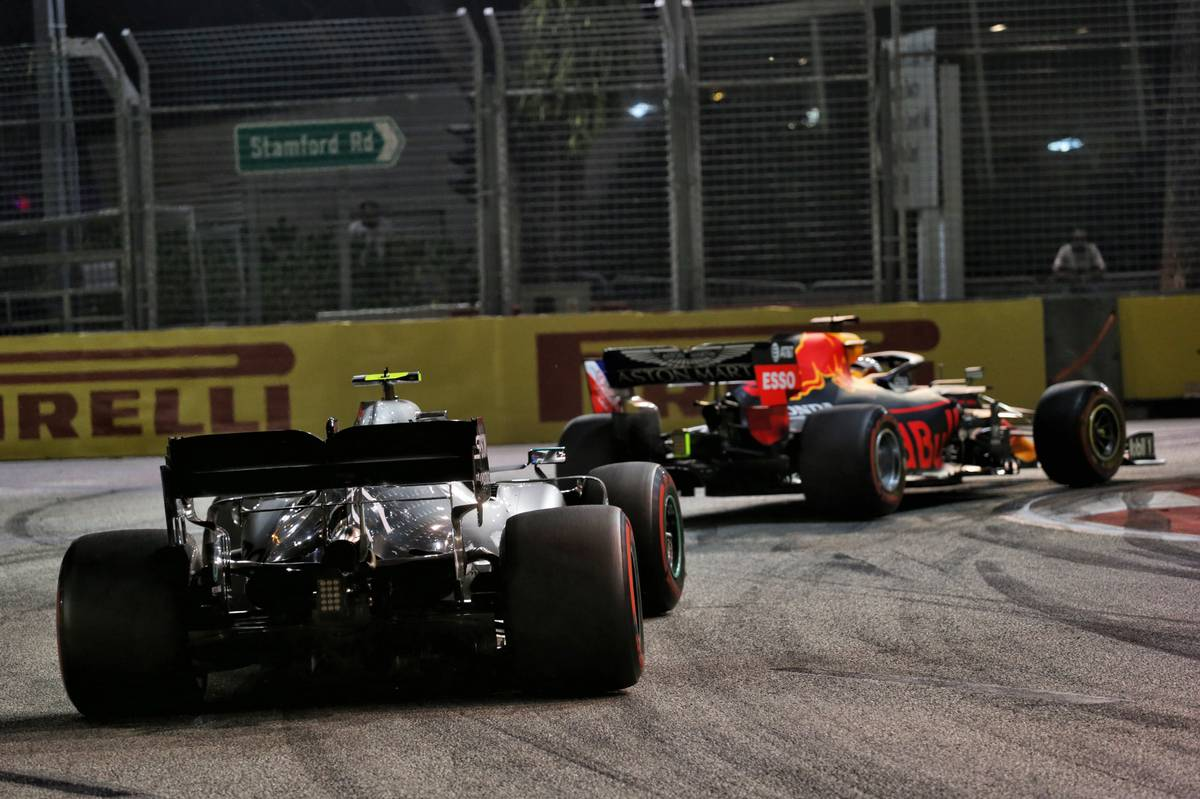 Max Verstappen (NLD) Red Bull Racing RB15 leads Valtteri Bottas (FIN) Mercedes AMG F1 W10.