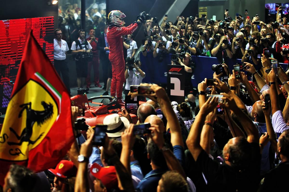 Race winner Sebastian Vettel (GER) Ferrari SF90 celebrates in parc ferme.