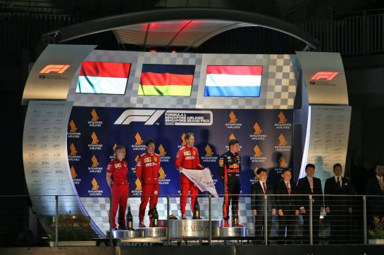 The podium (L to R): Inaki Rueda (ESP) Ferrari Race Strategist; Charles Leclerc (MON) Ferrari, second; Sebastian Vettel (GER) Ferrari, race winner; Max Verstappen (NLD) Red Bull Racing, third. 22.09.2019. Formula 1 World Championship, Rd 15, Singapore Grand Prix, Marina Bay Street Circuit, Singapore, Race Day. - www.xpbimages.com, EMail: requests@xpbimages.com - copy of publication required for printed pictures. Every used picture is fee-liable. © Copyright: Moy / XPB Images
