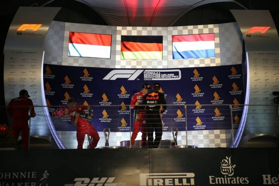 1st place Sebastian Vettel (GER) Ferrari SF90, 2nd place Charles Leclerc (MON) Ferrari SF90 and 3rd place Max Verstappen (NLD) Red Bull Racing RB15. 22.09.2019. Formula 1 World Championship, Rd 15, Singapore Grand Prix, Marina Bay Street Circuit, Singapore, Race Day.- www.xpbimages.com, EMail: requests@xpbimages.com - copy of publication required for printed pictures. Every used picture is fee-liable. © Copyright: Batchelor / XPB Images