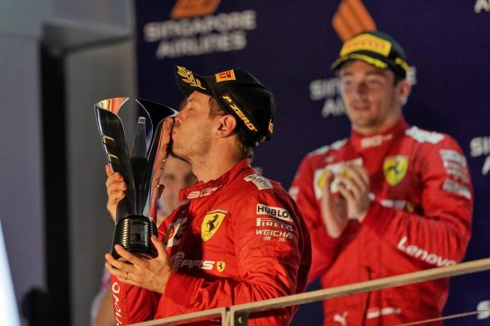 Race winner Sebastian Vettel (GER) Ferrari celebrates on the podium. 22.09.2019. Formula 1 World Championship, Rd 15, Singapore Grand Prix, Marina Bay Street Circuit, Singapore, Race Day.  - www.xpbimages.com, EMail: requests@xpbimages.com - copy of publication required for printed pictures. Every used picture is fee-liable. © Copyright: Dungan / XPB Images
