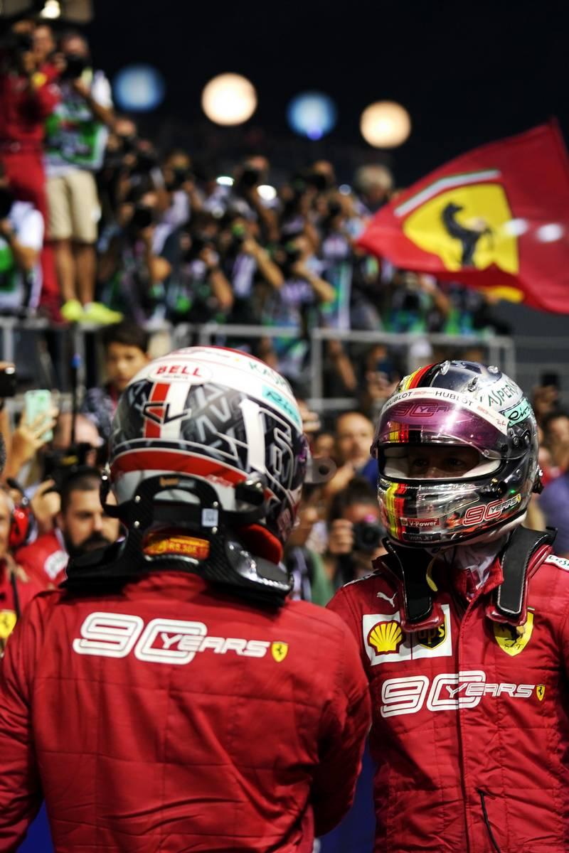 Charles Leclerc (MON) Ferrari and race winner Sebastian Vettel (GER) Ferrari in parc ferme.