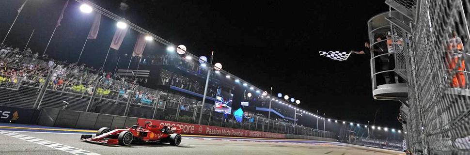 Race winner Sebastian Vettel (GER) Ferrari SF90 takes the chequered flag at the end of the race.